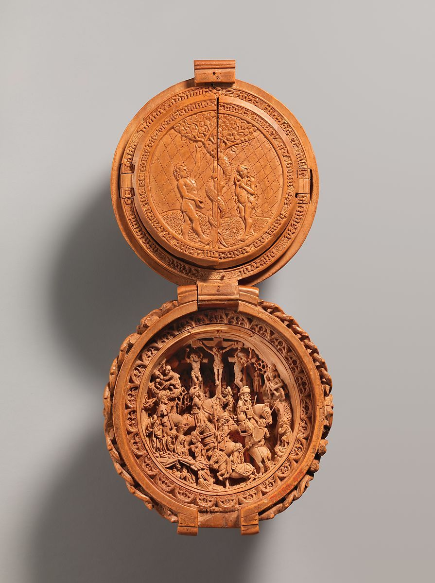 Adam and Eve and the Crucifixion are two of the scenes carved into the bead.